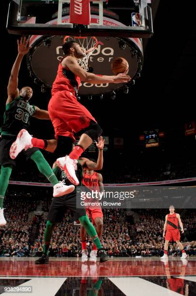 Evan Turner of the Portland Trail Blazers goes to the basket against the Boston Celtics on March 23 2018 at the Moda Center Arena in Portland Oregon...