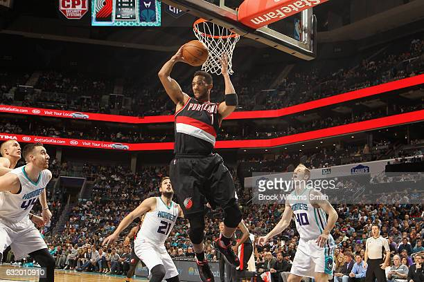 Evan Turner of the Portland Trail Blazers grabs the rebound against the Charlotte Hornets on January 18 2017 at Spectrum Center in Charlotte North...