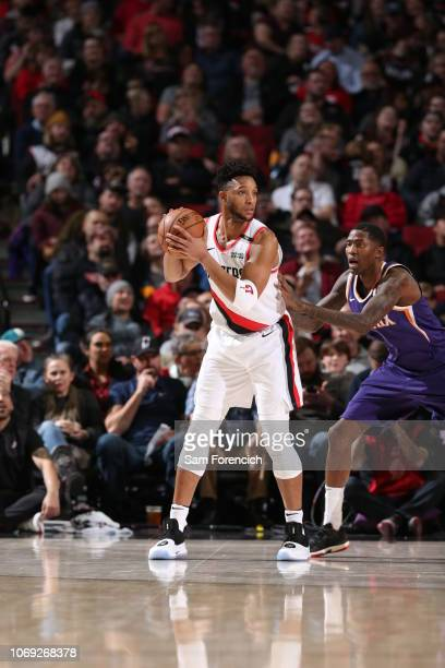Evan Turner of the Portland Trail Blazers handles the ball against the Phoenix Suns on December 6 2018 at the Moda Center Arena in Portland Oregon...