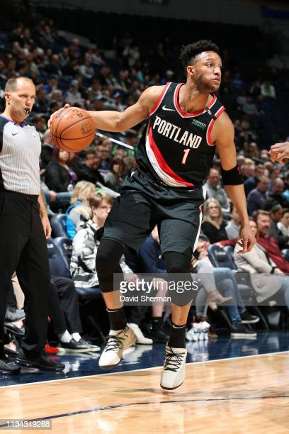 Evan Turner of the Portland Trail Blazers handles the ball against the Minnesota Timberwolves on April 1 2019 at Target Center in Minneapolis...