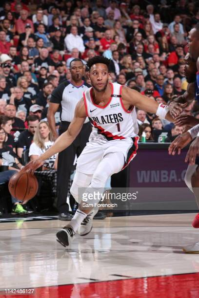 Evan Turner of the Portland Trail Blazers handles the ball against the Denver Nuggets during Game Six of the Western Conference Semifinals on May 9...