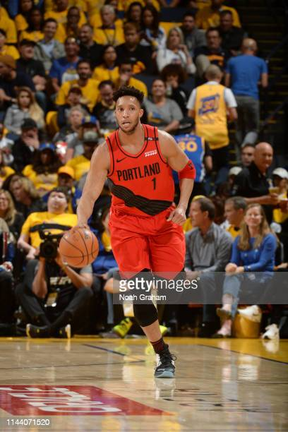 Evan Turner of the Portland Trail Blazers handles the ball against the Golden State Warriors during Game Two of the 2019 Western Conference Finals of...