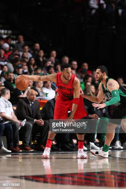 Evan Turner of the Portland Trail Blazers handles the ball against the Boston Celtics on March 23 2018 at the Moda Center in Portland Oregon NOTE TO...