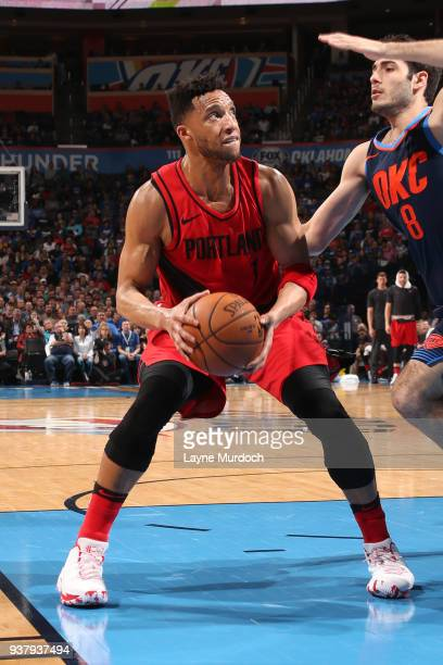 Evan Turner of the Portland Trail Blazers handles the ball against the Oklahoma City Thunder on March 25 2018 at Chesapeake Energy Arena in Oklahoma...