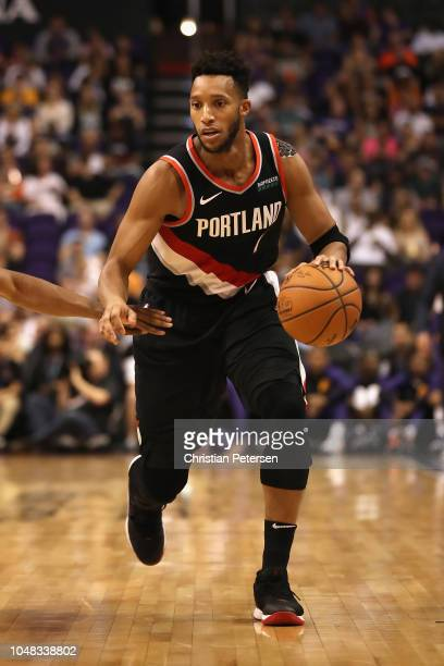 Evan Turner of the Portland Trail Blazers handles the ball during the second half of the NBA preseason game against the Phoenix Suns at Talking Stick...