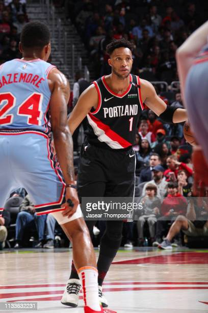 Evan Turner of the Portland Trail Blazers handles the ball during the game against Kent Bazemore of the Atlanta Hawks on March 29 2019 at State Farm...