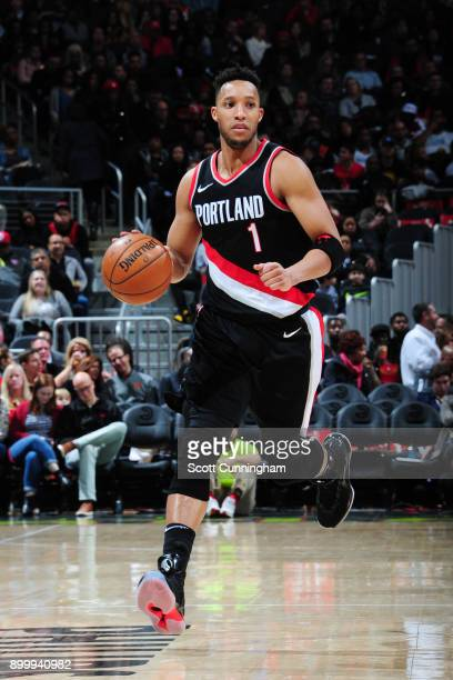 Evan Turner of the Portland Trail Blazers handles the ball during the game against the Atlanta Hawks on December 30 2017 at Philips Arena in Atlanta...