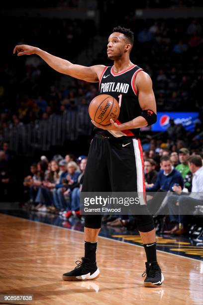 Evan Turner of the Portland Trail Blazers handles the ball during the game against the Denver Nuggets on January 22 2018 at the Pepsi Center in...