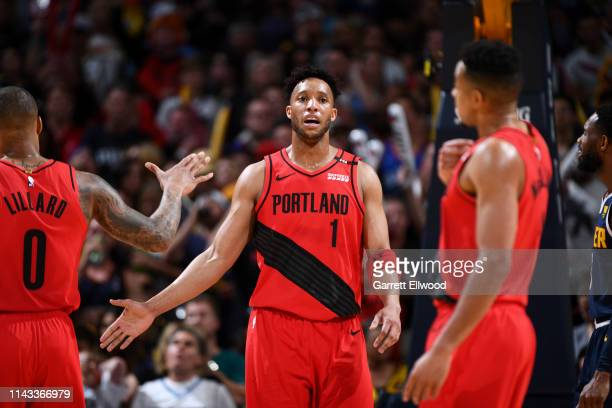 Evan Turner of the Portland Trail Blazers hifives teammates during Game Seven of the Western Conference SemiFinals of the 2019 NBA Playoffs against...