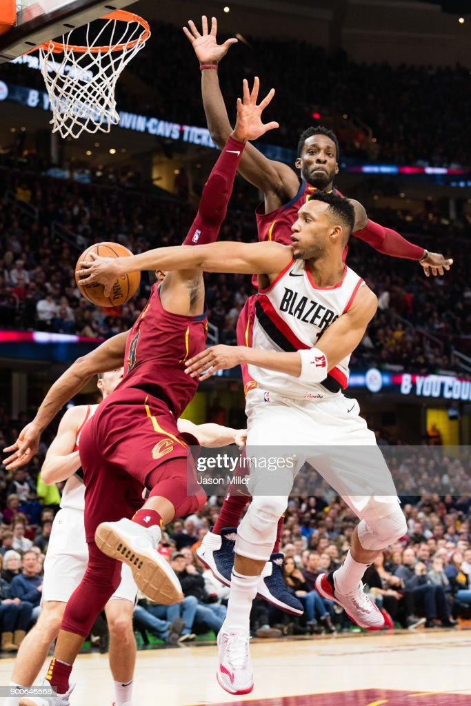 Evan Turner #1 of the Portland Trail Blazers passes around Dwyane Wade #9 and Jeff Green #32 of the Cleveland Cavaliers during the second half at Quicken Loans Arena on January 2, 2018 in Cleveland, Ohio. The Cavaliers defeated the Trail Blazers 127-110.