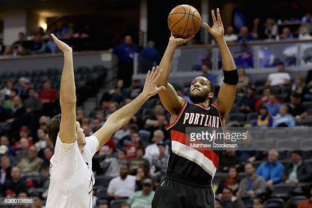 Evan Turner of the Portland Trail Blazers puts up a shot over Danilo Gallinari of the Denver Nuggets at the Pepsi Center on December 15 2016 in...
