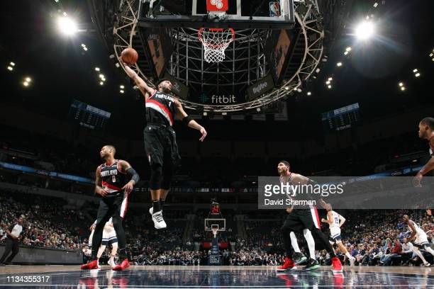 Evan Turner of the Portland Trail Blazers rebounds the ball against the Minnesota Timberwolves on April 1 2019 at Target Center in Minneapolis...