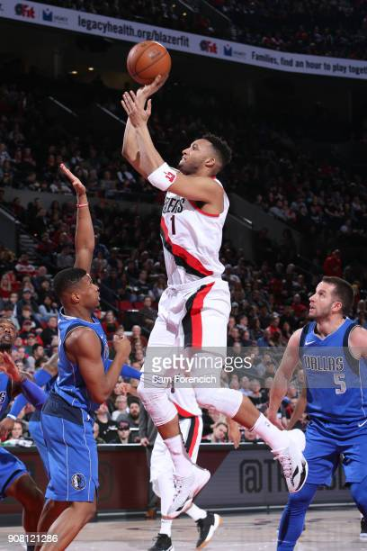 Evan Turner of the Portland Trail Blazers shoots the ball against the Dallas Mavericks on January 20 2018 at the Moda Center in Portland Oregon NOTE...