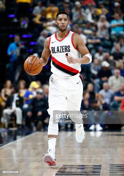 Evan Turner of the Portland Trailblazers dribbles the ball against the Indiana Pacers at Bankers Life Fieldhouse on October 20 2017 in Indianapolis...