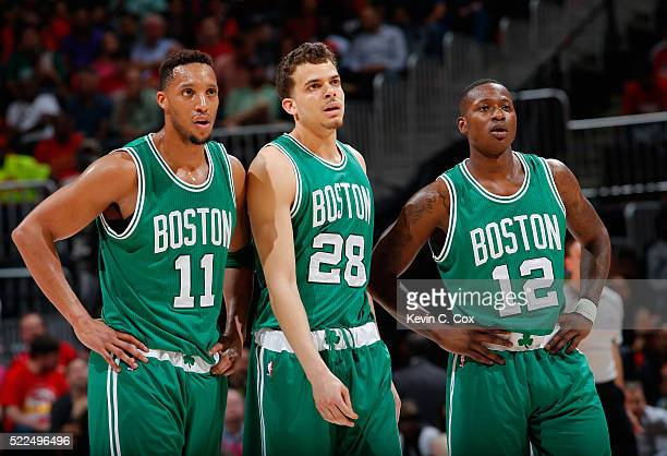 Evan Turner RJ Hunter and Terry Rozier of the Boston Celtics watch an Atlanta Hawks free throw after Rozier was called for a technical foul in Game...