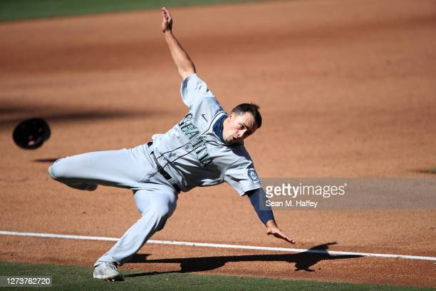 Evan White falls rounding third base enroute to scoring on an RBI double hit by Tim Lopes of the Seattle Mariners during the fifth inning of a game...