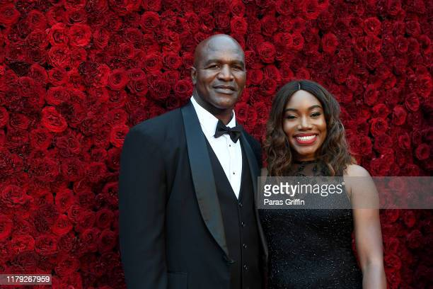 Evander Holyfield and guest attend Tyler Perry Studios grand opening gala at Tyler Perry Studios on October 05 2019 in Atlanta Georgia