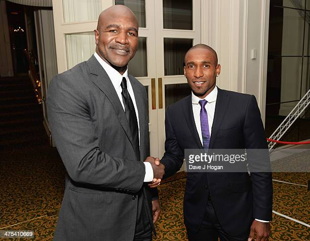 Evander Holyfield and Jermain Defoe attend a charity auction for The Jermain Defoe Foundation on September 9 2013 in London England
