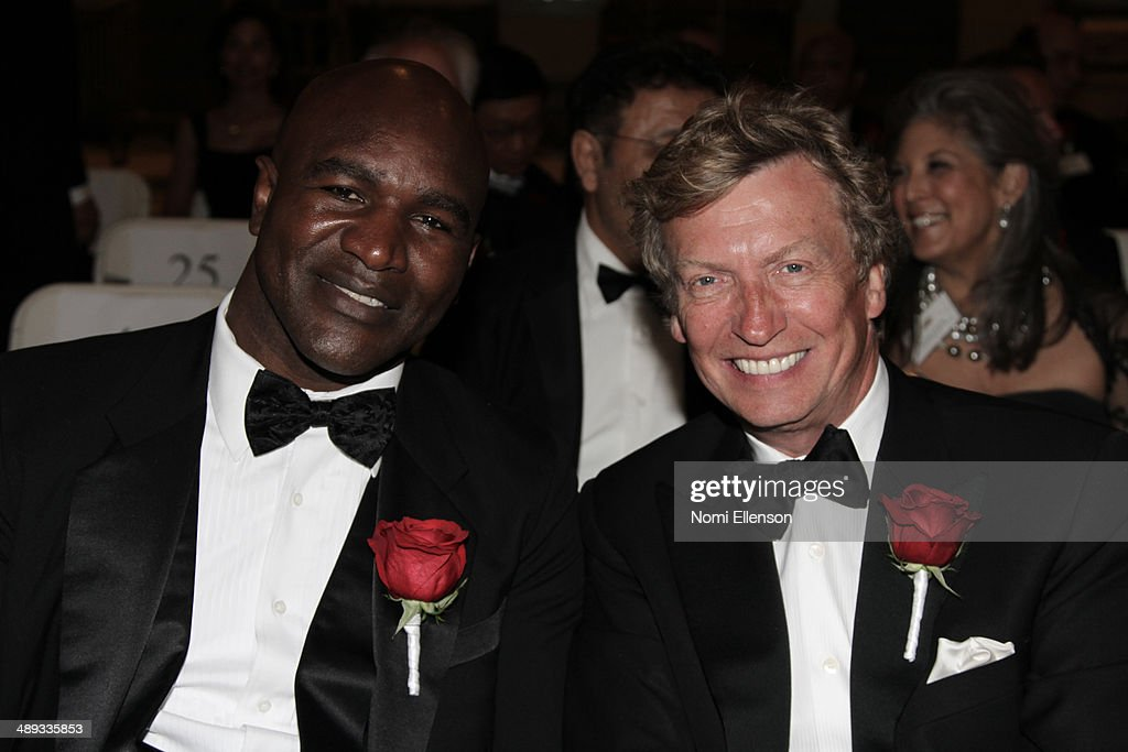 Evander Holyfield and Nigel Lythgoe attends the 2014 Ellis Island Medals Of Honor at Ellis Island on May 10, 2014 in New York City.