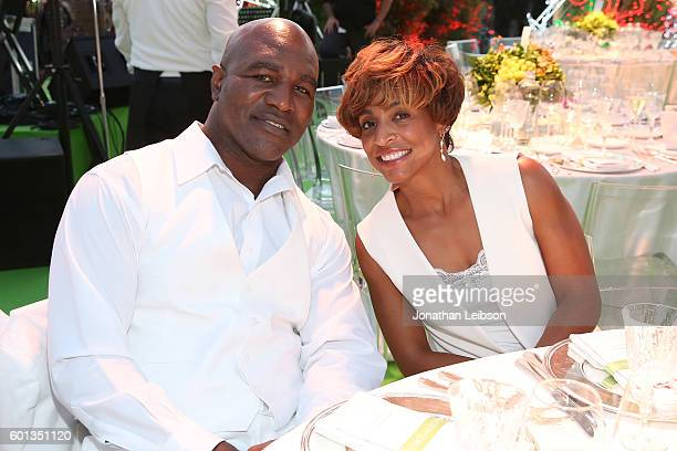 Evander Holyfield and Shevon Harris attend a dinner and reception at Andrea Bocelli's country home as part of Celebrity Fight Night Italy benefiting...