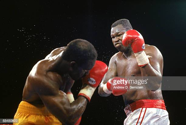 Evander Holyfield cuts and dodges against Larry Holmes as they compete for the WBC WBA IBF Heavyweight Titles in a bout schedule for twelve rounds at...