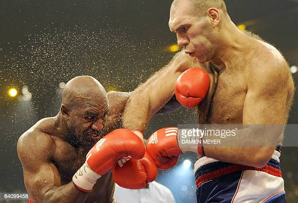 US Evander Holyfield fights against Russia's Nikolai Valuev for the WBA heavyweight title on December 20 2008 at Hallenstadion in Zurich Valuev...