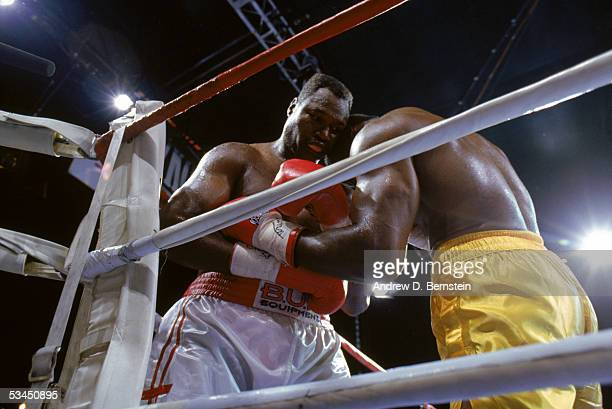 Evander Holyfield has Larry Holmes against the ropes as they compete for the WBC WBA IBF Heavyweight Titles in a bout schedule for twelve rounds at...