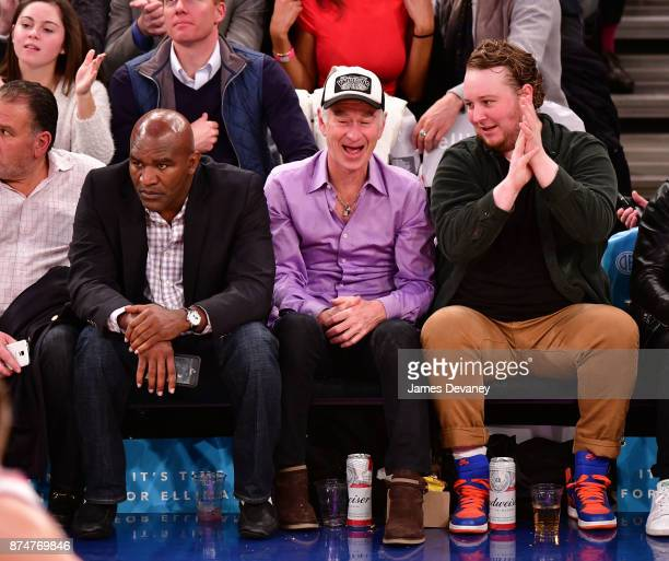 Evander Holyfield John McEnroe and guest attend the Utah Jazz Vs New York Knicks game at Madison Square Garden on November 15 2017 in New York City