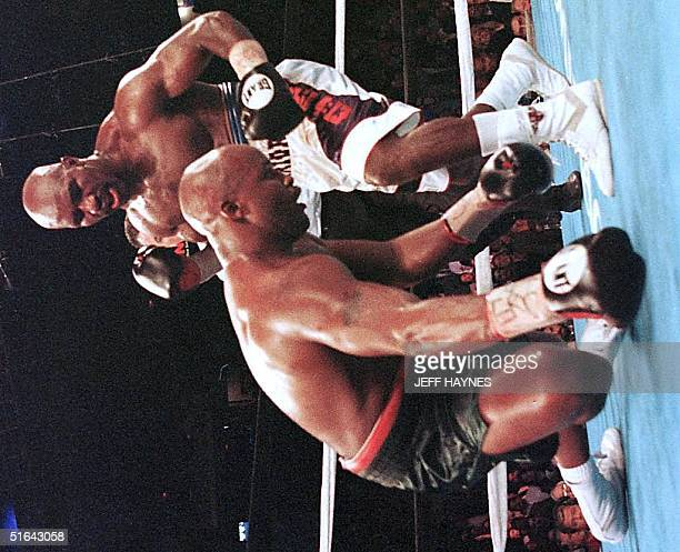 Evander Holyfield knocks down Michael Moorer in the seventh round of their WBA/IBF Heavyweight Championship Unification fight 08 November in Las...