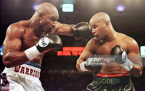 Evander Holyfield lands a left hook on Michael Moorer in the second round of their WBA/IBF Heavyweight Championship Unification fight 08 November in...