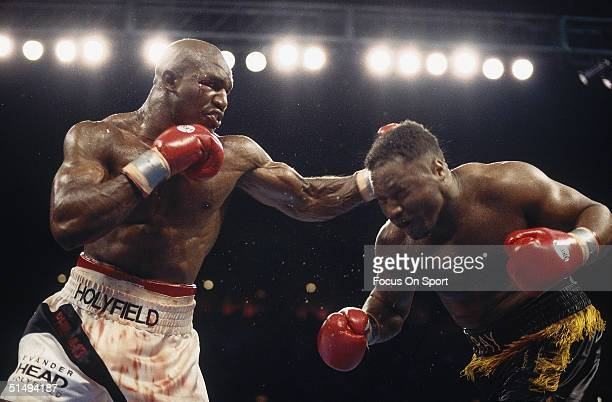 Evander Holyfield lands a punch to the back of Ray Murcer's Head in Atlantic City New Jersey on May 20 1995 Evander Holyfield was declared the winner...