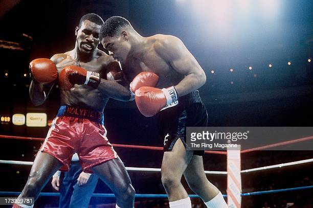 Evander Holyfield looks to land a punch against Lionel Byarm during the fight at Madison Square Garden in New York New York Evander Holyfield won by...