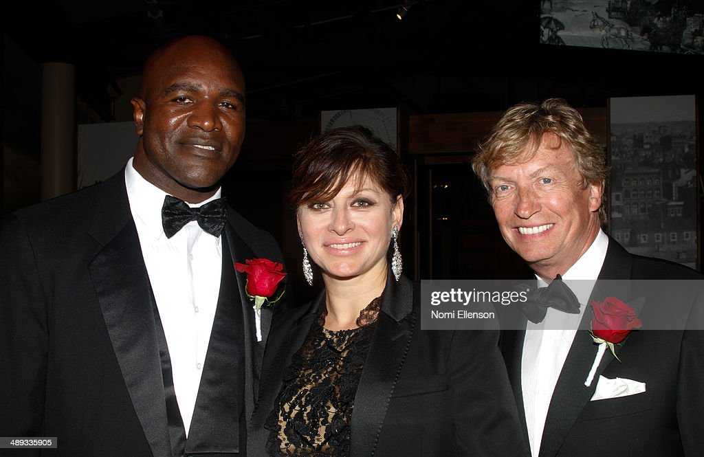 Evander Holyfield, Maria Bartiromo, and Nigel Lythgoe attend the 2014 Ellis Island Medals Of Honor at Ellis Island on May 10, 2014 in New York City.