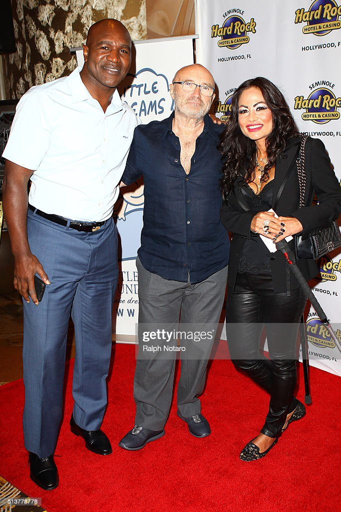 Evander Holyfield, Phil Collins, and Orianne Cevey pose for photos during Little Dreams Foundation Press Conference at LBar in Seminole Hard Rock Hotel & Casino Hollywood on March 4, 2016 in Hollywood, Florida.