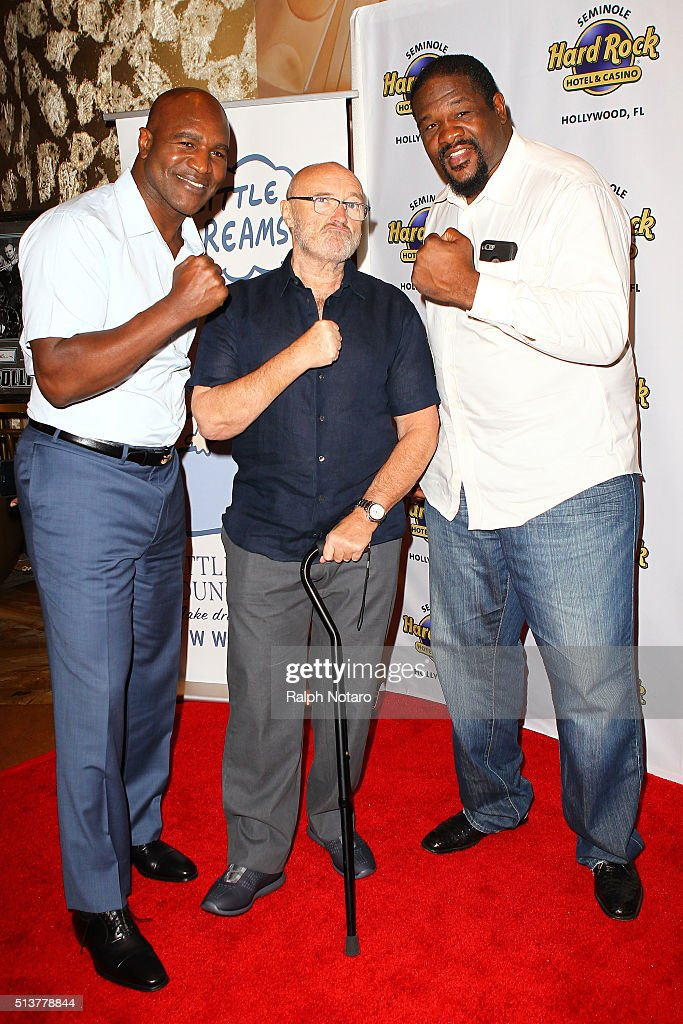 Evander Holyfield, Phil Collins, and Riddick Bowe pose for photos during Little Dreams Foundation Press Conference at LBar in Seminole Hard Rock Hotel & Casino Hollywood on March 4, 2016 in Hollywood, Florida.