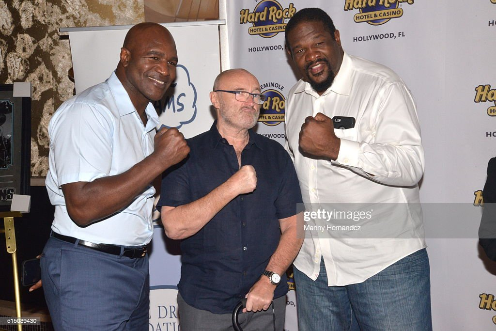 Evander Holyfield, Phil Collins, Riddick Bowe attends Press Conference for Little Dreams Foundation at Seminole Hard Rock Hotel & Casino – Hard Rock Cafe Hollywood on March 4, 2016 in Hollywood, Florida.