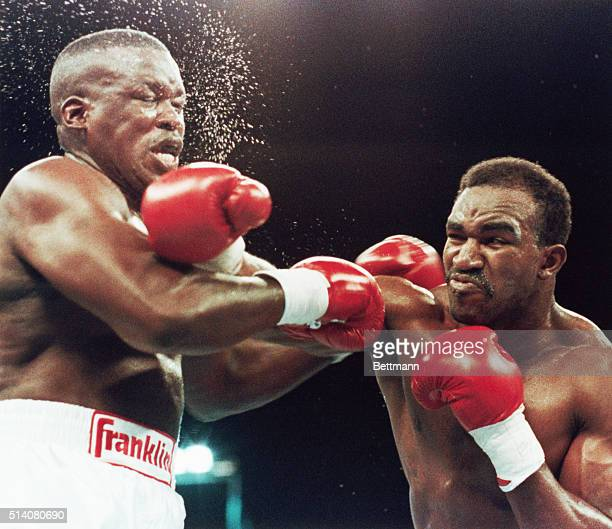 Evander Holyfield slams former heavyweight champ Buster Douglas with a right punch in the third and final round of their title fight, Las Vegas,...