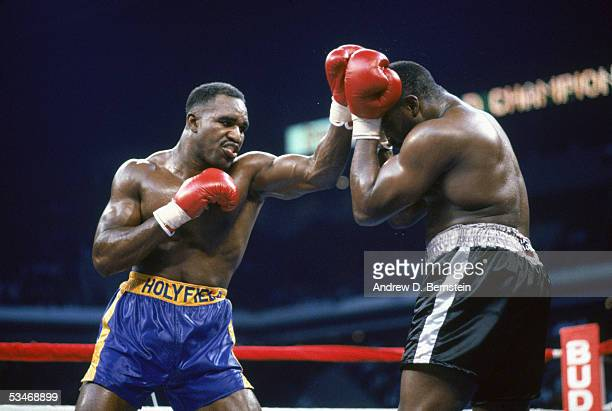 Evander Holyfield throws a punch against Bert Cooper on November 23 1991 at the The Omni in Atlanta Georgia Evander Holyfield wins on a TKO