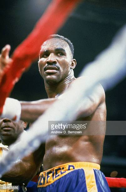 Evander Holyfield waits in the corner between rounds during a fight against Bert Cooper on November 23 1991 at the The Omni in Atlanta Georgia...