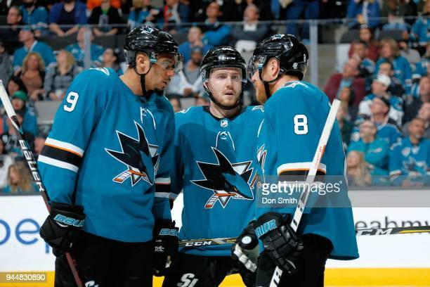 Evander Kane Chris Tierney and Joe Pavelski of the San Jose Sharks chat during a NHL game against the Minnesota Wild at SAP Center on April 7 2018 in...