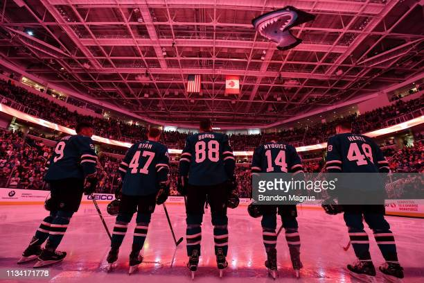 Evander Kane Joakim Ryan Brent Burns Gustav Nyquist and Tomas Hertl of the San Jose Sharks stand for the national anthem against the Calgary Flames...
