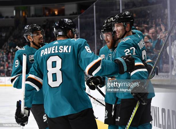 Evander Kane Joe Pavelski Joakim Ryan and Joonas Donskoi of the San Jose Sharks celebrate scoring a goal against the Edmonton Oilers at SAP Center on...