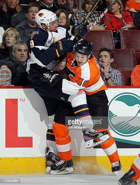 Evander Kane of the Atlanta Thrashers takes a check from Daniel Briere of the Philadelphia Flyers during the first period on March 12 2011 at Wells...