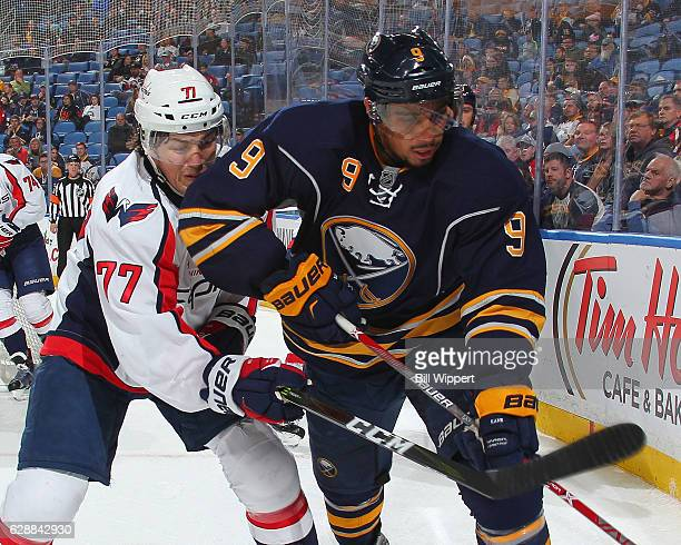 Evander Kane of the Buffalo Sabres battles for the puck against TJ Oshie of the Washington Capitals during an NHL game at the KeyBank Center on...