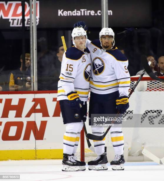 Evander Kane of the Buffalo Sabres celebrates his shorthanded goal at 1009 of the second period against the New York Islanders and is joined by Jack...