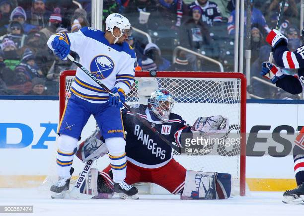 Evander Kane of the Buffalo Sabres deflects a second period shot into the crossbar behind Henrik Lundqvist of the New York Rangers during the 2018...