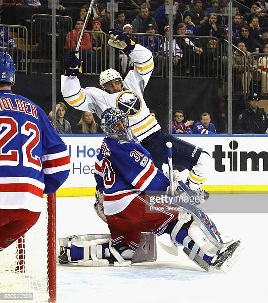 Evander Kane of the Buffalo Sabres scores at 1921 of the first period against Henrik Lundqvist of the New York Rangers at Madison Square Garden on...