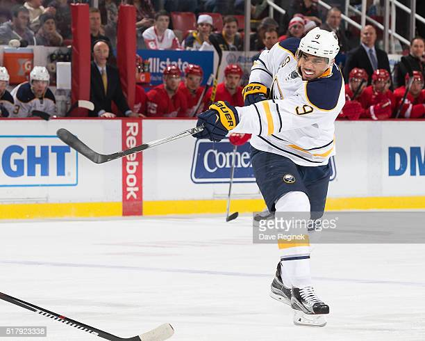Evander Kane of the Buffalo Sabres shoots the puck during an NHL game against the Detroit Red Wings at Joe Louis Arena on March 28 2016 in Detroit...