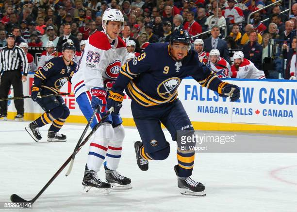 Evander Kane of the Buffalo Sabres skates against Ales Hemsky of the Montreal Canadiens during an NHL game on October 5 2017 at KeyBank Center in...