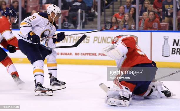 Evander Kane of the Buffalo Sabres takes a shot on James Reimer of the Florida Panthers during a game at BBT Center on April 8 2017 in Sunrise Florida